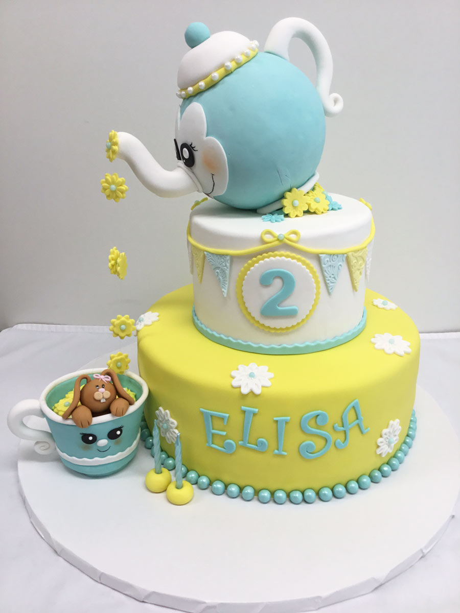 tea cup and kettle pastel blue and yellow Yummy Yonie Cakes